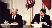Soviet President Mikhail Gorbachev and U.S. President Ronald Reagan sign the Intermediate-Range Nuclear Forces treaty at the White House in Washington Dec. 8 1987. (CNS photo/Reuters)