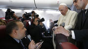 Pope Francis listens to a question from Romanian journalist Cristian Micaci aboard his flight from Sibiu, Romania, to Rome June 2, 2019. (CNS photo/Paul Haring)