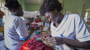 Nurse Annet Kojo feeds a 4-day-old baby girl in the maternity ward of the St. Daniel Comboni Catholic Hospital in Wau, South Sudan, on April 16, 2018. (CNS photo/Paul Jeffrey)