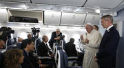 Pope Francis answers questions from reporters aboard his flight from Tokyo to Rome on Nov. 26, 2019. (CNS photo/Paul Haring)
