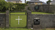 This June 4, 2014 file photo shows the site of a mass grave for children who died in the Tuam mother and baby home, in Tuam, County Galway, Ireland. The Vatican has indicated its support for a campaign to exhume the bodies of hundreds of babies who were buried on the grounds of a Catholic-run Irish home for unwed mothers to give them a proper Christian burial. (Niall Carson/PA via AP, file)