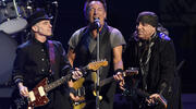 Bruce Springsteen performs with Nils Lofgren, left, and Steven Van Zandt of the E Street Band during their concert at the Los Angeles Sports Arena in Los Angeles, March 15, 2016. (Photo by Chris Pizzello/Invision/AP, File)