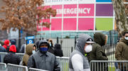 People wearing protective gear wait in line to be tested for the coronavirus (COVID-19) outside Elmhurst Hospital Center in the Queens borough of New York City March 25, 2020. (CNS photo/Stefan Jeremiah, Reuters)