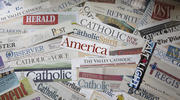 The numbers show that Catholic print publications are still an effective means of communication. (CNS photo/Tyler Orsburn)