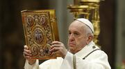 Pope Francis raises the Book of the Gospels as he celebrates Mass marking the feast of the Epiphany in St. Peter's Basilica at the Vatican
