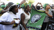 Supporters for president elect Cyril Ramaphosa outside parliament in Cape Town, South Africa, on Feb 15. Mr. Ramaphosa on Thursday was elected as South Africa's new president by ruling party legislators after the resignation of Jacob Zuma. (AP Photo/Nasief Manie)