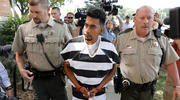 Cristhian Bahena Rivera is escorted into the Poweshiek County Courthouse for his initial court appearance, Wednesday, Aug. 22, 2018, in Montezuma, Iowa. (AP Photo/Charlie Neibergall)