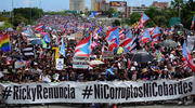 Thousands of Puerto Ricans joined one of the biggest protests ever seen in the U.S. territory, with irate islanders pledging to drive Gov. Ricardo Rossello from office, in San Juan, Puerto Rico on July 22. (AP Photo/Carlos Giusti)