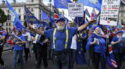 Anti-Brexit demonstrators march at Parliament Square, in London, on Tuesday, Sept. 3. (AP Photo/Alberto Pezzali)