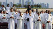 With the Chicago skyline in the background, deacons pray as participants gather to end violence and promote peace during the eighth annual Sunrise Prayer Service and Mass on Aug. 26, 2017. (CNS photo/Karen Callaway, Chicago Catholic)