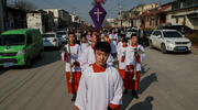 Altar servers lead a Palm Sunday procession March 25 in Youtong, in China's Hebei province. (CNS photo/Damir Sagolj, Reuters)