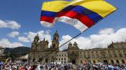 A man waves a Colombian flag in Bogota, Colombia, in this 2015 file photo (CNS photo/John Vizcaino, Reuters).