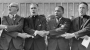 Rev. Dr. Martin Luther King Jr. with The University of Notre Dame President Rev. Theodore M. Hesburgh, C.S.C., Rev. Edgar Chandler (far left), and Msgr. Robert J. Hagarty of Chicago (far right) at the Illinois Rally for Civil Rights in Chicago's Soldier Field, 1964. (The University of Notre Dame Archives)