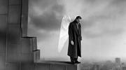 "In Wim Wenders's film ""Wings of Desire,"" the protagonist, an angel named Damiel (Bruno Ganz), is tired of spending eternity as a pure spirit (photo: Alamy)."