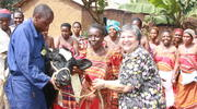 "With Veterinary Technician Jude's help, Sister Toni Temporiti, C.P.P.S., hands over a pregnant cow to Guadencia, a farmer in Masaka, Uganda, marking the beginning of her ""living loan"" in 2012. (Photo by Heather Cammarata)"