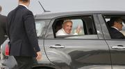 Pope Francis waves as he rides away in a Fiat after a short arrival ceremony on the airfield at Joint Base Andrews outside Washington Sept. 22, 2015. (CNS photo/Jonathan Ernst, Reuters)