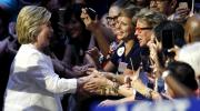 Democratic presidential candidate Hillary Clinton, left, is greeted by supporters as she arrives to a presidential primary election night rally, Tuesday in New York. (AP Photo/Julio Cortez)