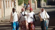 "Women walk along a street Feb. 20, 2016, in Asmara, Eritrea. The nation's bishops said that because of years of war and unrest, ""young people, mothers, children and families have become victims of exile and of destabilization."" (CNS photo/Thomas Mukoya, Reuters)"