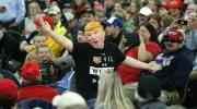 A not-necessarily-anxious man wears a Donald J. Trump mask at the Republican presidential candidate's rally ol Saturday in Rothschild, Wis. (AP Photo/Charles Rex Arbogast)