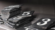 Number tiles await placement on the hymnal board. (iStock/linephoto)