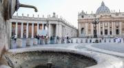 A dry fountains is seen in St. Peter's Square at the Vatican on July 24. The Vatican says it is shutting off all its fountains, including those in St. Peter's Square, because of Italy's drought. (Alessandro Di Meo/ANSA via AP)