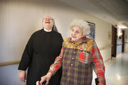 Sister Jean Dwyan laughs with a resident at the St. Louis Residence of the Little Sisters of the Poor in January 2014. (CNS photo/Lisa Johnston, St. Louis Review)