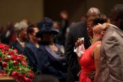 Michael Brown's mother is comforted during his funeral in St. Louis. (CNS photo/Robert Cohen, pool via EPA)