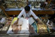 A vendor displays a blanket with an image of Pope Francis Jan. 27, to be sold inside a store of religious items in Mexico City. (CNS photo/Edgard Garrido, Reuters)