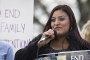 Beatriz Mejia of El Salvador speaks at a rally in front of the White House in Washington in March 2016 in support of immigrant families who are seeking asylum. (CNS photo/Tyler Orsburn)