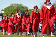 Graduating seniors line up to receive their diplomas after exiting their vehicles during a drive-in commencement on June 14, 2020, at St. John the Baptist Diocesan High School in West Islip, N.Y. (CNS photo/Gregory A. Shemitz)