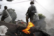 Military police clear a barricade set up overnight by protestors supporting opposition presidential candidate Salvador Nasralla in Tegucigalpa, Honduras, Monday Dec. 18, 2017. (AP Photo/Fernando Antonio)