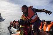 A woman is rescued by aid workers of Spanish NGO Proactiva Open Arms in the Central Mediterranean Sea on Dec. 21, 2018. (AP Photo/Olmo Calvo)