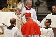 Pope Francis places a red biretta on new Cardinal Pedro Barreto of Huancayo, Peru, during a consistory to create 14 new cardinals in St. Peter's Basilica at the Vatican June 28. (CNS photo/Paul Haring)