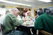 Inmates share a meal at a spiritual retreat held by Thrive for Life at the Otisville Correctional Facility in Otisville, N.Y. (photo courtesy of Thrive for Life)