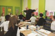 Cardinal Dolan celebrated Mass and visited classrooms during his tour of Saint Francis Xavier School in the Bronx in Oct. 2013.
