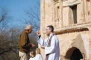 TAKE THIS. Sean Carroll, S.J., gives Communion during Mass at Tumacacori National Historical Park in Tumacacori, Ariz., Jan. 10.