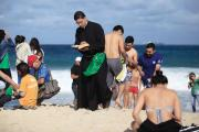 BEACH READING: A priest reads the Bible as he waits for the arrival of Pope Francis on Copacabana Beach during World Youth day in Rio de Janeiro on July 26.