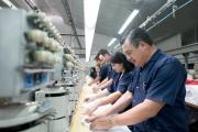 Workers at an embroidery factory (iStock/andresr)