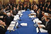 AT THE TABLE. Members of the Senate and House Appropriations Committees hash out differences between versions of legislation in the L.B.J. Room at the U.S. Capitol in February 2009.