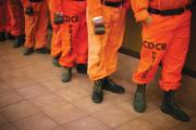 FIREBREAK. Prison inmates line up for breakfast at Oak Glen Conservation Fire Camp #35 in Yucalpa, Calif, in 2014.