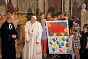 CLOSER TOGETHER Pope Francis receives a gift from children during a visit to Christuskirche, a parish of the German Evangelical Lutheran Church in Rome, on Nov. 15, 2015