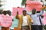 LAW MEN. Men in Kampala, Uganda, Feb. 24, celebrate a new anti-homosexuality law, which imposed a harsh punishment for homosexual acts. The law was struck down in August, but a similar new bill is being considered.