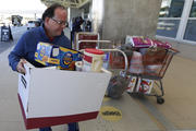 A food and supply donation for unpaid but working Transportation Safety Administration agents lands at Orlando International Airport on Jan. 16. (AP Photo/John Raoux)