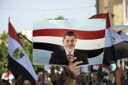 NOT FORGOTTEN: A protester raises a sign in support of deposed president Mohamed Morsi on June 21, 2013.