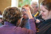 TOUCH OF GRACE. Ann Froelich, pastoral associate at St. Matthew Parish in Allouez, Wis., gives ashes.