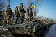 IDENTITY CRISIS. Ukrainian armed forces ride on armored personnel carriers near Debaltseve, Ukraine, Feb. 12.