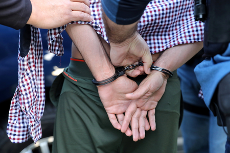 U.S. Immigration and Customs Enforcement officers arrest a man in San Clemente, Calif., May 11, 2017 (CNS photo/Lucy Nicholson, Reuters).