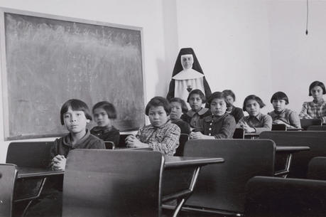 A 1940 photo shows indigenous students and a nun in a girls' classroom at Cross Lake Indian Residential School in Manitoba. (CNS photo/Library and Archives Canada, Reuters)