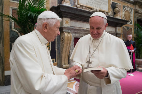 "Pope Francis is not the first: Pope Benedict XVI also called for a ""civil economy,"" in his encyclical ""Caritas in Veritate."" (Retired Pope Benedict XVI being greeted by Pope Francis on June 28, 2016. CNS photo/L'Osservatore Romano, handout)"