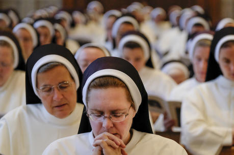 Dominican Sisters of St. Cecilia pray during Mass at the Cathedral of the Incarnation in Nashville, Tenn., on July 24, 2016. Members of religious orders who come from abroad and take a vow of poverty may find it more difficult to remain in the United States. (CNS photo/Rick Musacchio, Tennessee Register)